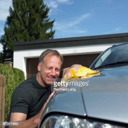 Man polishing car : Stock Photo