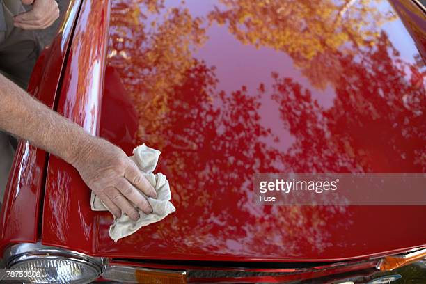 Man Polishing the Hood of His Car