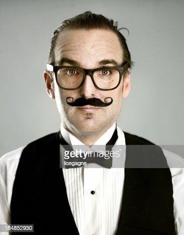 Man portrait wearing fake mustache
