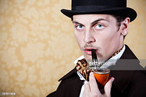 Man portraying Sherlock Holmes with pipe and hat