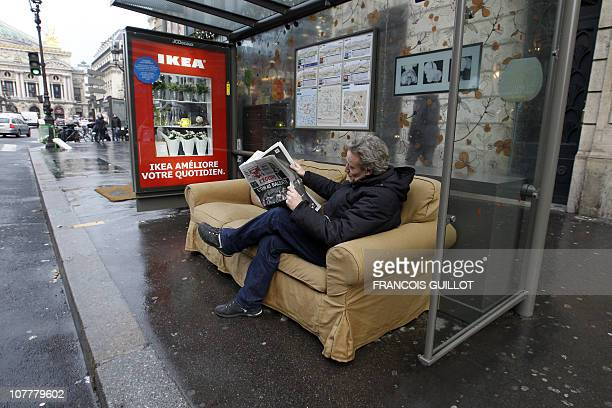 A man poses at a bus station in a couch that was placed there by Swedish homefurnishing giant Ikea to promote its products on December 20 2010 in...