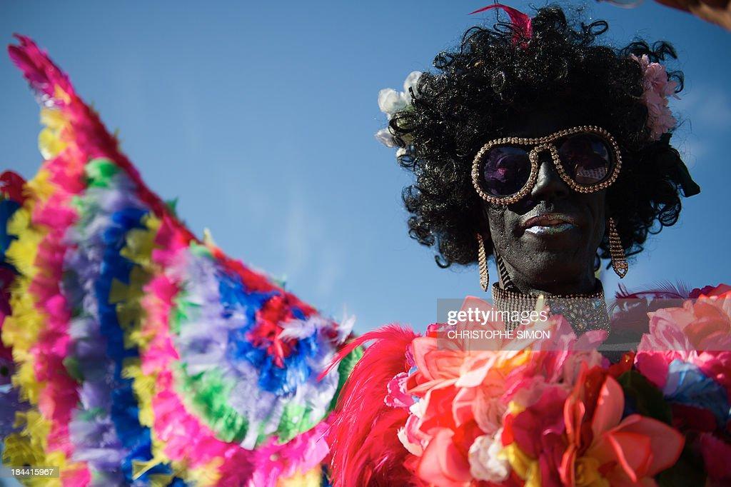 A man poses during the gay pride parade at Copacabana beach in Rio de Janeiro, Brazil on October 13, 2013.