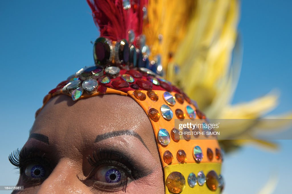 A man poses during the gay pride parade at Copacabana beach in Rio de Janeiro, Brazil on October 13, 2013.