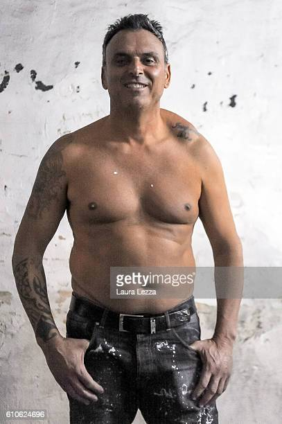 A man poses for a photo just after the annual Festa dei Gigli with his shoulder strain called 'patana' or 'pataniello' caused by having carried a...