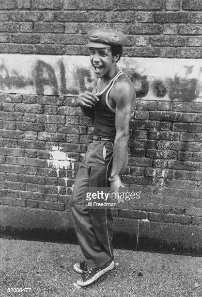 A man poses for a photograph against a wall in New York City 1976
