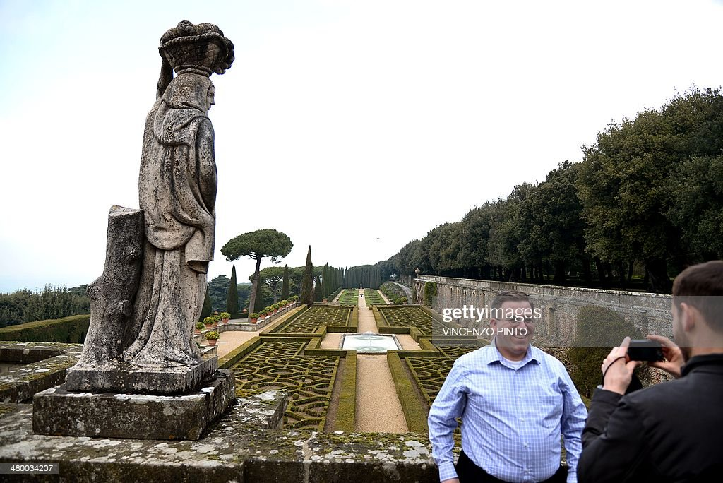 A man poses for a picture as he visits the Belvedere in the gardens of pope's summer residence of Castel Gandolfo, south of Rome, on March 22, 2014 in Castel Gandolfo. From March 1st, the gardens surrounding the papal summer residence are open to the public. Located south of Rome in the Alban hills, the property includes the extensive Barberini gardens, the remains of a Roman villa and a 62 acre farm, as well as the ancient papal palace. A statement from the director of the Vatican Museums says it was Pope Francis himself who decided to make accessible to all the gardens of the Pontifical Villas. A guided tour of the gardens, in Italian or English, will be available to individuals or groups through an online booking system. CREDIT 'AFP PHOTO/VINCENZO PINTO' - NO