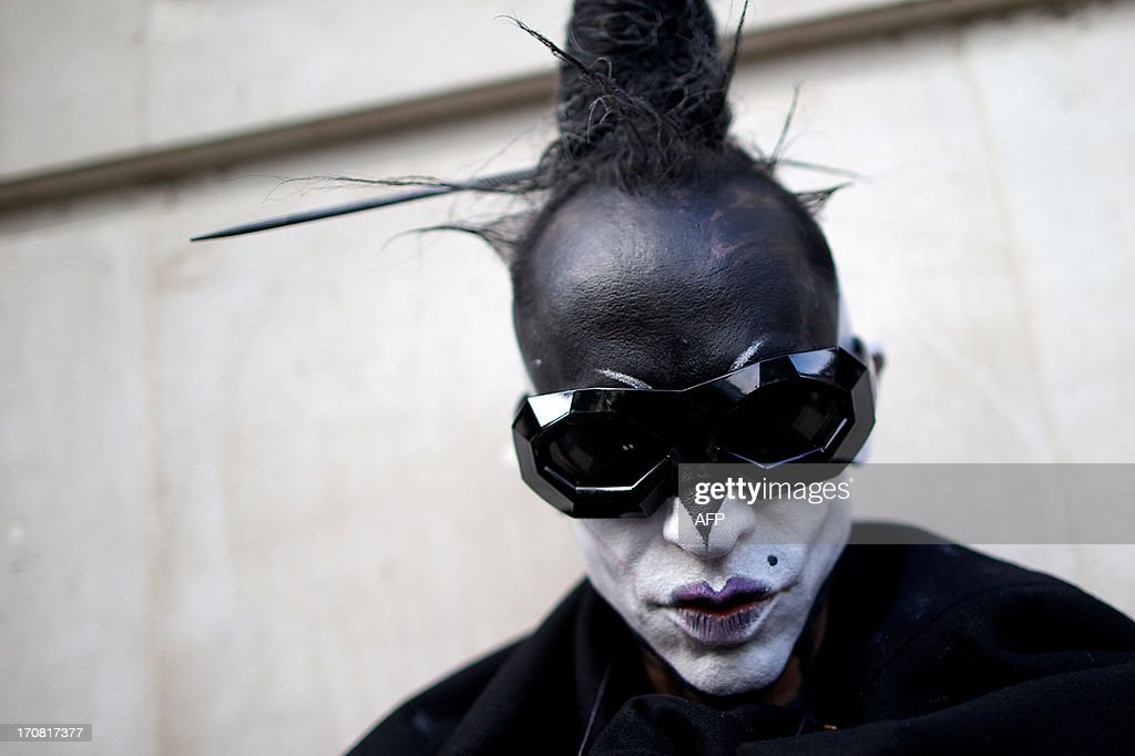 A man poses for pictures during the Spring/Summer 2014 London Collections: Men fashion event in London on June 18, 2013.