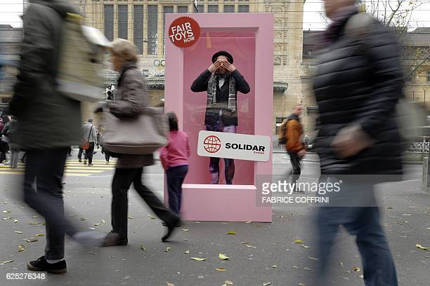 TOPSHOT A man poses in a giant box during a protest against toymaker Mattel on November 23 2016 in Lausanne A fleshandblood version of Ken the fiance...