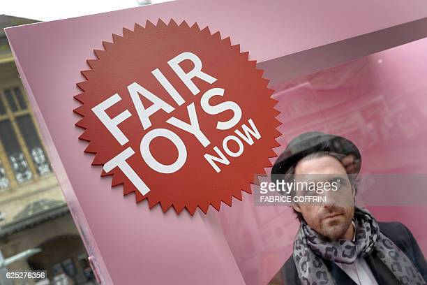 A man poses in a giant box during a protest against toymaker Mattel on November 23 2016 in Lausanne A fleshandblood version of Ken the fiance of the...