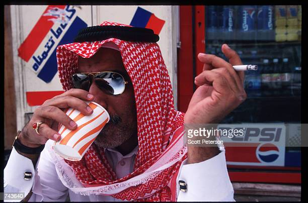 A man poses while drinking tea July 15 1996 in Jeddah Saudi Arabia Possessing twentyfive percent of the world's oil reserves and the Islamic shrines...