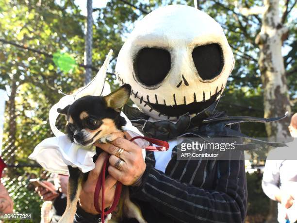 A man poses with his dog in costume during the 27th Annual Tompkins Square Halloween Dog Parade in Tompkins Square Park in New York on October 21...