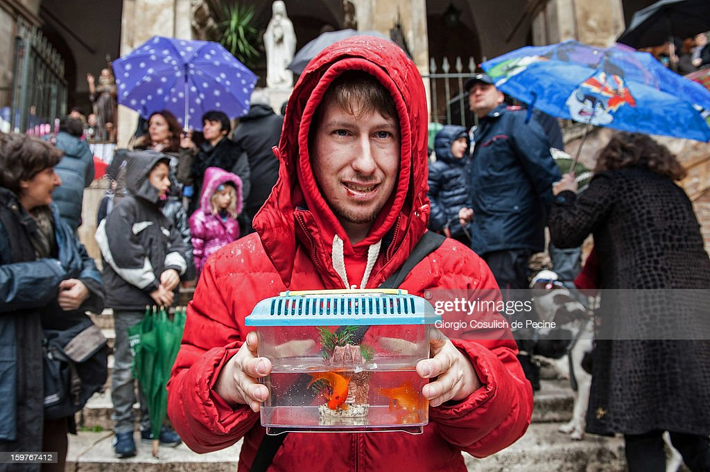 A man poses with his pet goldfish after a traditional mass for the blessing of animals at the Sant'Eusebio church on January 20, 2013 in Rome, Italy. Every year during the feast of St. Anthony the Abbot animals are blessed in countries around the world.