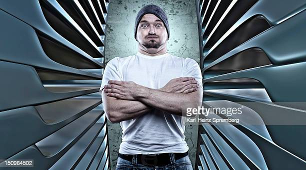 Man posing like a macho with his arms crossed