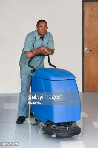 Man Posing While Cleaning an Office - Janitorial Services Series