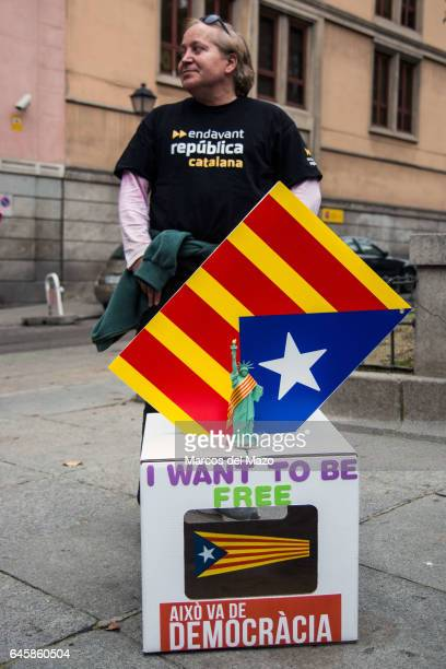 A man posing with a ballot supporting Francesc Homs as he goes to declare for allowing ballots for an independence referendum in Catalonia