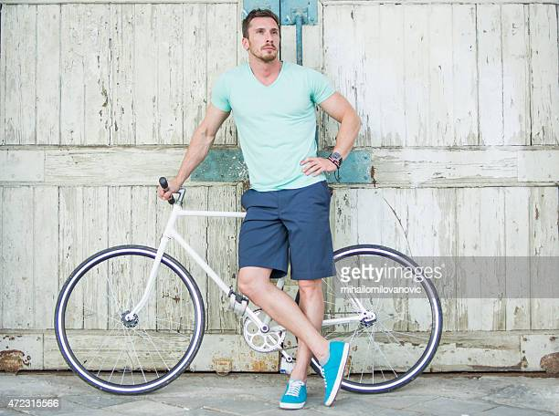 Man posing with bicycle