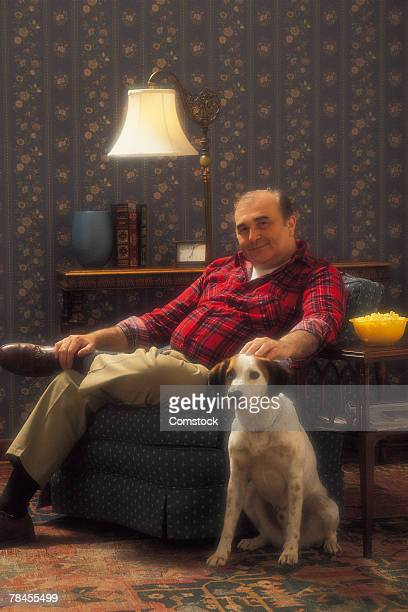 Man posing with dog in living room