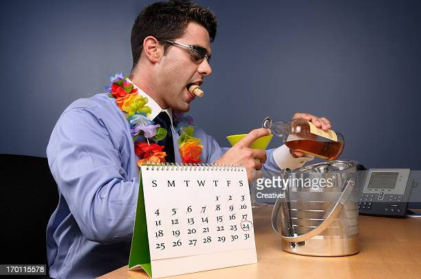 Man pouring drink in office