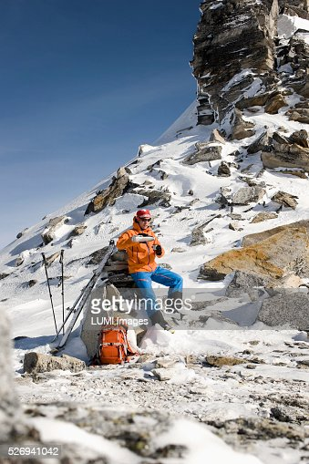Man pouring from vacuum flask in mountain landscape, Weissenseegletscher, Salzburg, Austria : Stock Photo