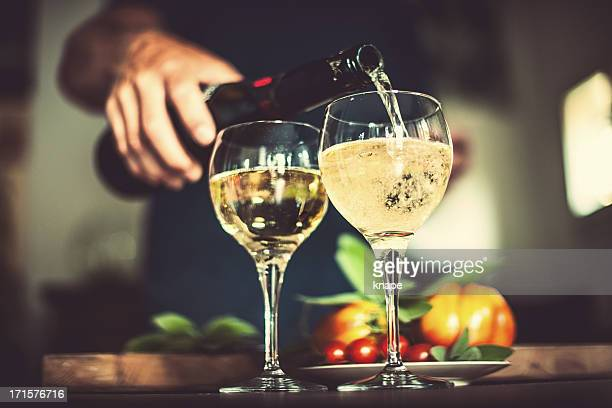 Man pouring sparkling wine