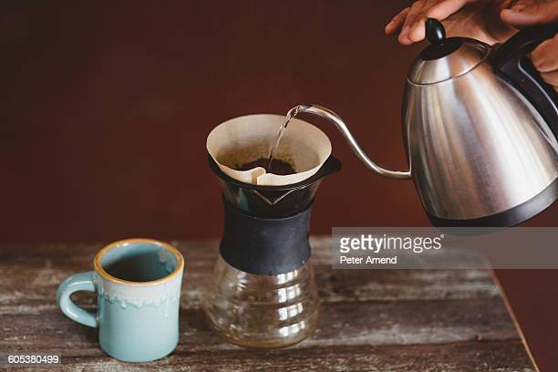Man pouring water into filter coffee maker