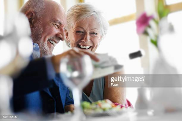 Man Pouring Wine for Wife