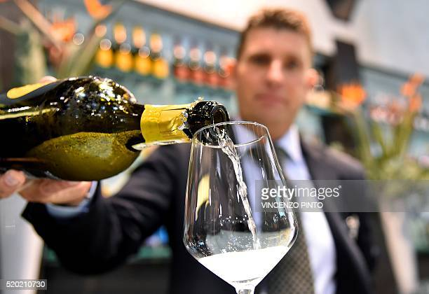 A man pours a glass of wine on April 10 2016 during the 50th edition of the Vinitaly wine exhibition in Verona Vinitaly is the worlds largest wine...