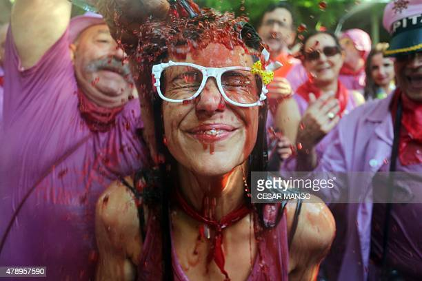 A man pours red wine on a girl's head during the'Batalla del Vino' in Haro on June 29 2015 Every year thousands of locals and tourists climb a...