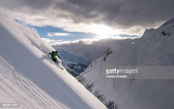 Man Powder Skiing at sunset, Lech, Austria