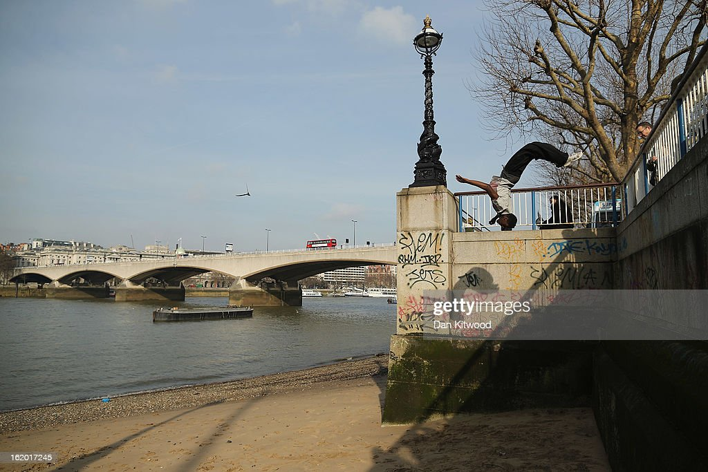 A man practices 'Free Running' moves on the South Bank on February 18, 2013 in London, England.