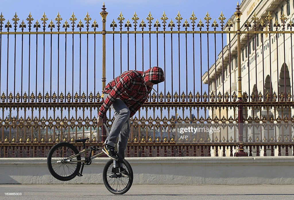A man practices freestyle BMX during a clear and windy day in Vienna on March 17, 2013.