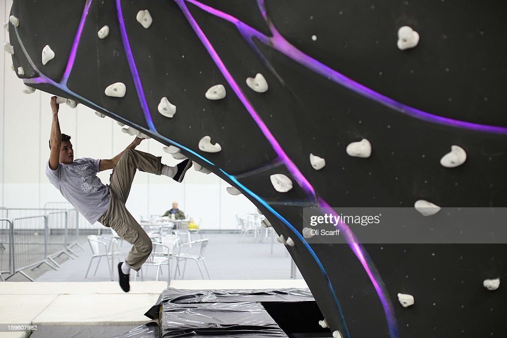A man practices his bouldering at The Outdoors Show which is being held in the ExCeL Centre on January 17, 2013 in London, England. The ExCeL centre is hosting The Outdoors Show, the London Bike Show and the Active Travel Show which run until January 20, 2013 and features manufacturer trade stalls, speeches, demonstrations and areas where visitors can climb or ride bikes.