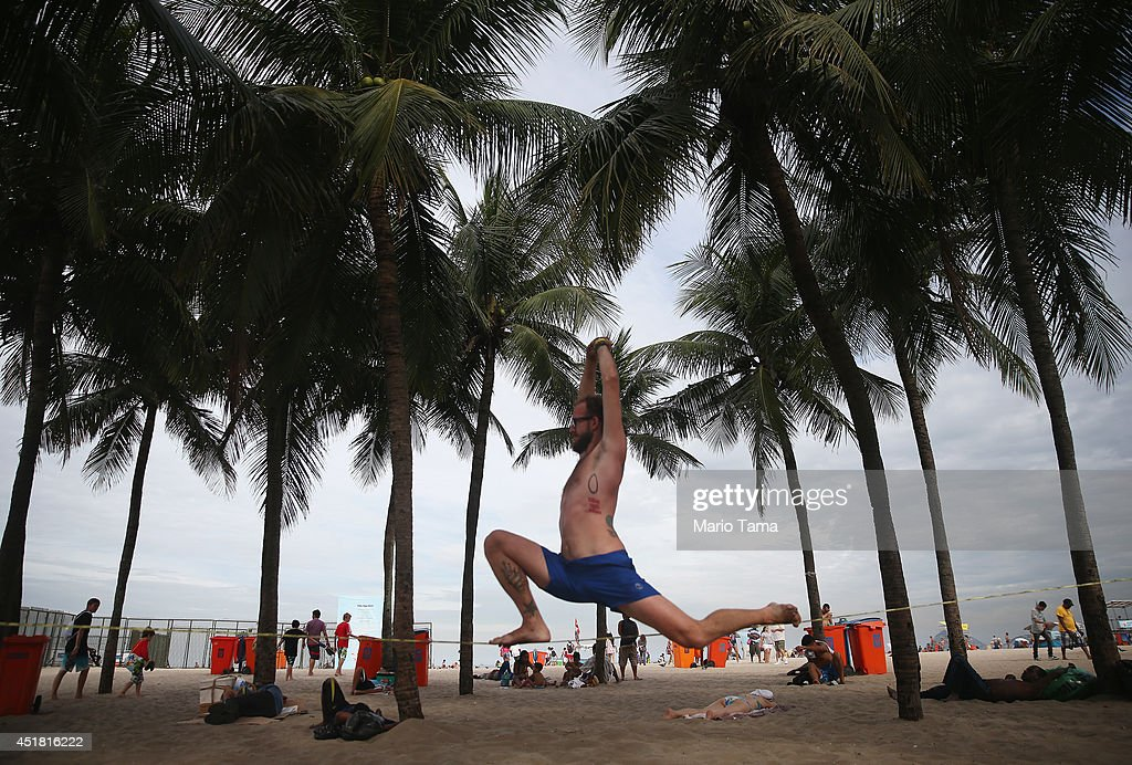 A man practices slacklining on Copacabana Beach on July 7, 2014 in Rio de Janeiro, Brazil. Brazil plays Germany tomorrow in the first semi-final match of the 2014 FIFA World Cup.