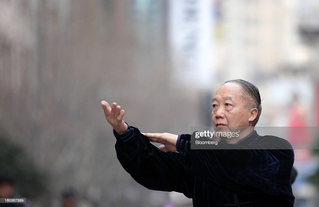 A man practices Tai Chi in the East Nanjing Road area in Shanghai, China, on Tuesday, Jan. 29, 2013. China's economic growth accelerated for the first time in two years as government efforts to revive demand drove a rebound in industrial output, retail sales and the housing market. Photographer: Tomohiro Ohsumi/Bloomberg via Getty Images