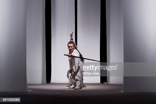 Man Practicing Martial Arts in Ancient Costumes