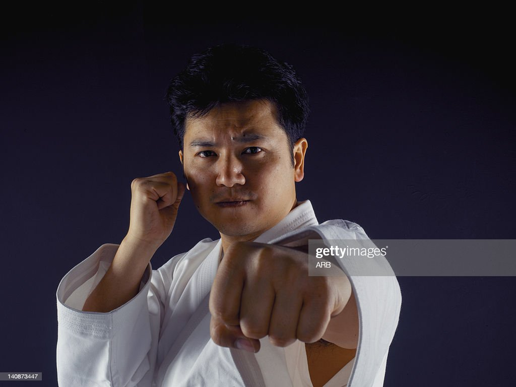 Man practicing martial arts : Stock Photo