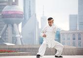 Man practicing Tai Chi, Shanghai, China