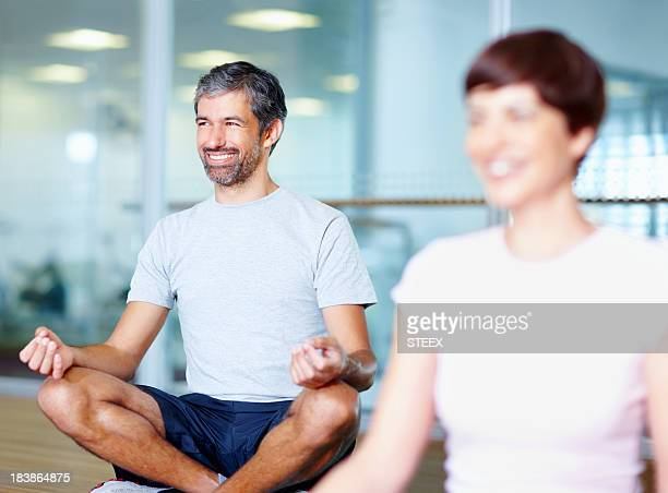 Man practicing yoga in lotus position
