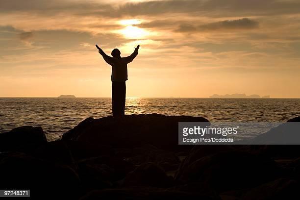 Man praying at a beach, Koh Lanta, Thailand