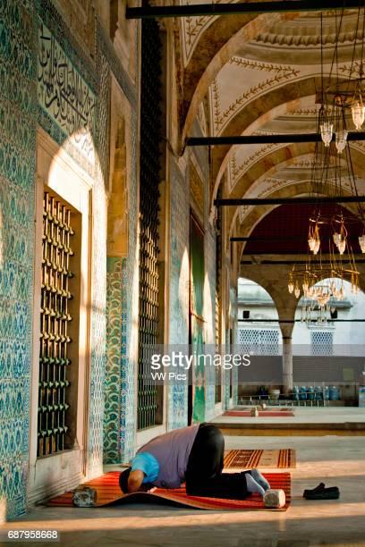 Man praying in Rustem Pasha Mosque Istanul Turkey