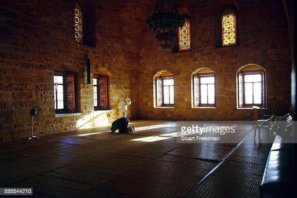 A man prays alone at the Imam Khomayni mosque in Tyre Lebanon