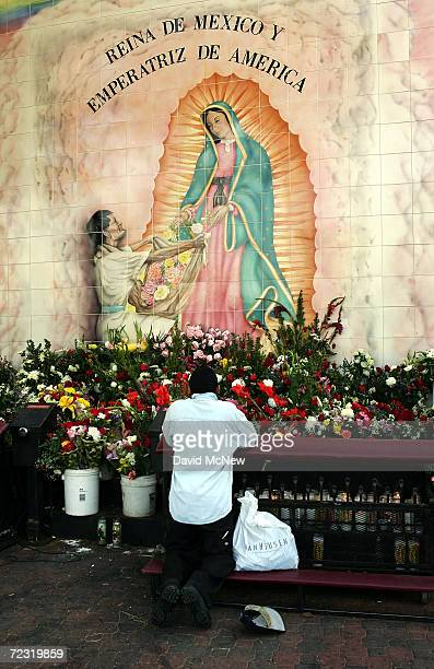 A man prays at an alter outside the Iglesia de la Placita at Nuestra Senora Reina de Los Angeles or Our Lady Queen of Angeles Church on March 31 2005...