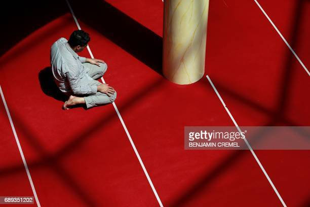 A man prays at the Grand Mosque of SaintDenis near Paris on May 28 2017 during the holy fasting month of Ramadan More than 15 billion Muslims around...
