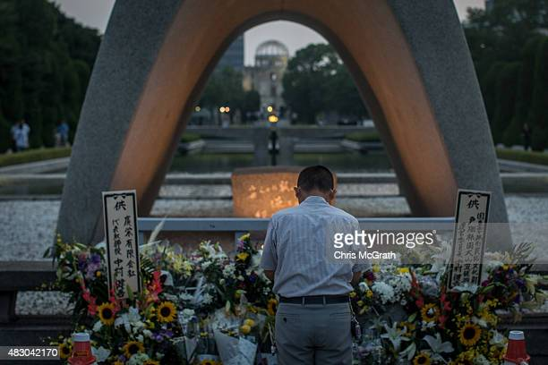 A man prays at the Hiroshima Peace Memorial ahead of the 70th anniversary ceremony of the atomic bombing of Hiroshima at the Hiroshima Peace Memorial...