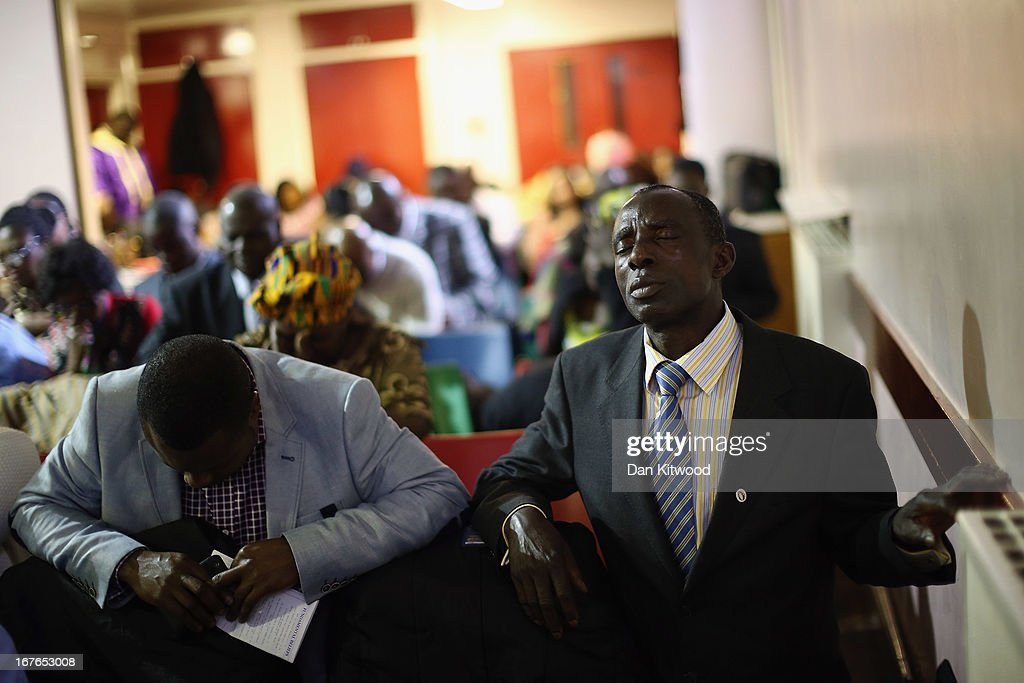 A man prays during a 'Seventh Day Evangelist' service at Crossway Church in the Heygate Estate on April 27, 2013 in London, England. The Crossway Church is an international church, with the congregation made up of native Londoners as well as people from Ghana, Jamaica, South Africa, Zimbabwe, Korea, Brazil, Eastern Europe and the United States. It has been serving the local community at different sites around Elephant and Castle for almost 150 years. The church has been at it's current location in the Heygate estate since 1974. The Heygate estate in central London was built in 1974 as social housing and housed around 3000 people, but fell into a state of disrepair, gaining a reputation for crime and poverty. The estate is due to be demolished as part of the £1.5billion GBP 'Elephant & Castle regeneration scheme', and replaced with 2,500 affordable new homes. The area has become popular with street artists, storytellers, and guerilla gardeners and attracts an array of urban wildlife including bats, birds and mammals.