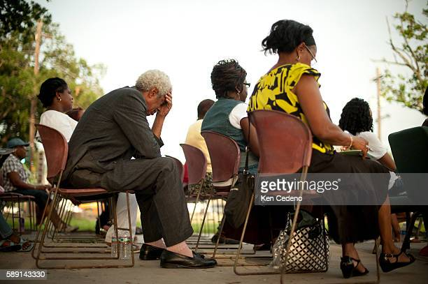 A man prays during a St Paul Church of God in Christ tent revival in the lower 9th ward of New Orleans July 15 2010 Five years after historical...