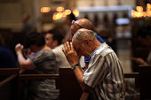 A man prays during mass at St Patrick's Cathedral the seat of the Roman Catholic Archdiocese of New York on September 8 2015 in New York City Just in...