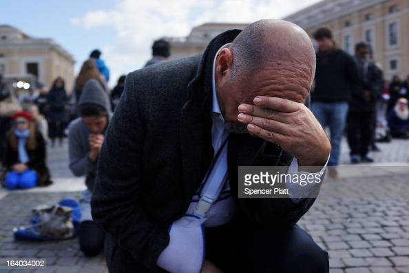 A man prays during the Inauguration Mass for Pope Francis in St Peter's Square on March 19 2013 in Vatican City Vatican The mass is being held in...