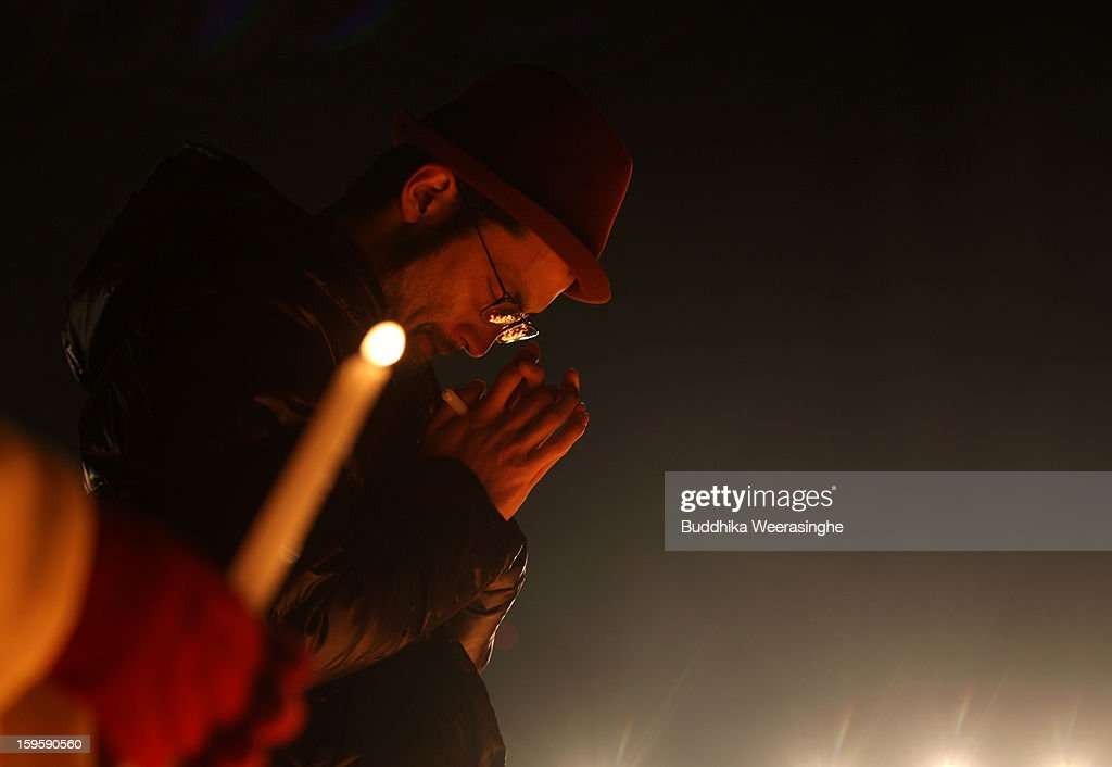 A man prays for victims of the 1995 'Great Hanshin earthquake' during a memorial ceremony on January 17, 2013 in Kobe, Japan. Memorial services were held to mark the 18th anniversary of the 1995 massive earthquake, hundreds of people gathered early this morning to pay their respects and light bamboo lanterns in the park for more than 6,400 people who lost their lives in the 7.3 magnitude earthquake.