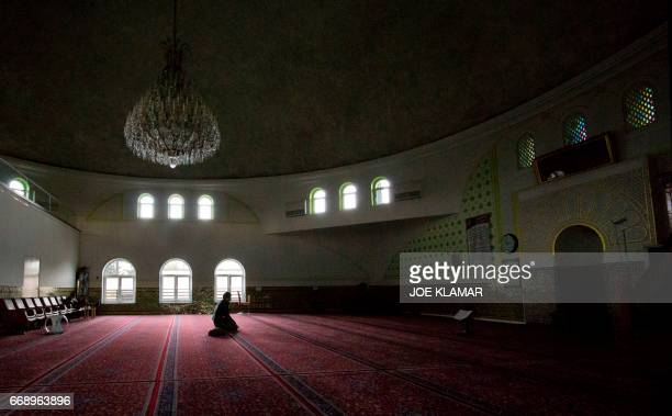 A man prays in a mosque of Islam Centre of Vienna on April 14 2017 in Vienna Austria A debate is raging in Austria after a study suggested that...